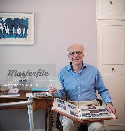 Older man looking through photo album