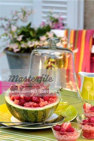 Summer fruit salad served in half a watermelon