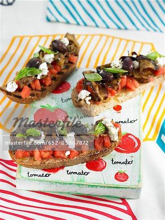 Tomato,eggplant and goat's cheese Bruschettas