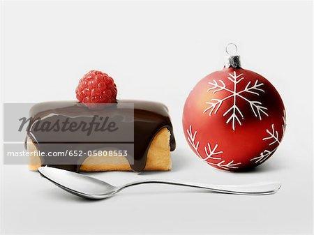 Chocolate and raspberry individual log cake and Christmas tree ball