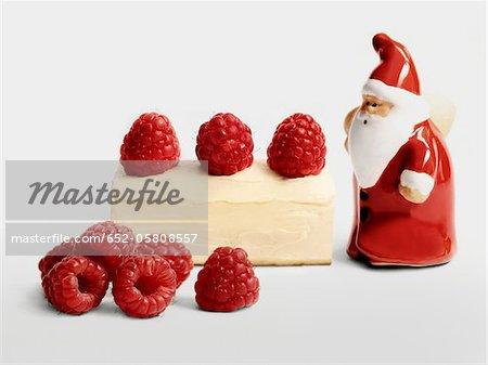 Christmas raspberry individual log cake with a Santa Claus figurine