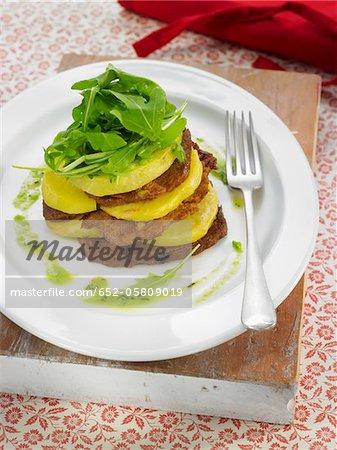 Layered seitan and potatoes,pea puree,mint and rocket lettuce