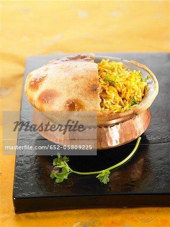 Biryani chicken with cardamom-flavored Basmati rice