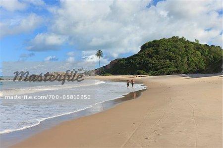 Couple Walking on Beach, Praia de Tabatinga, Paraiba, Brazil