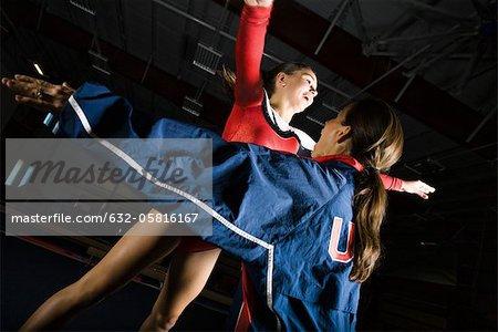 Female gymnast training with coach