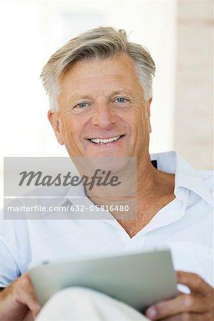 Man using digital tablet, portrait