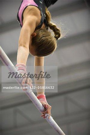 Female gymnast on horizontal bar