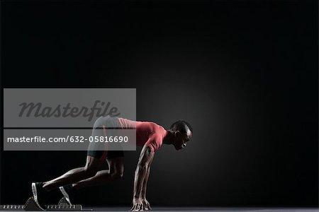 Male athlete on starting block