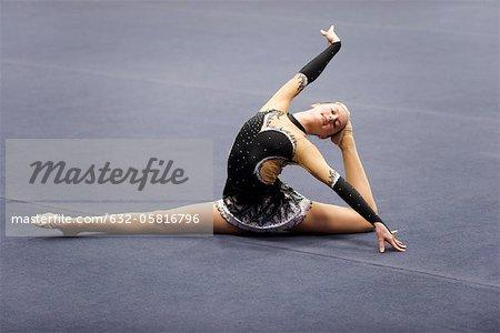 Female gymnast performing floor routine