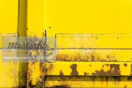 Detail of a rusty yellow door
