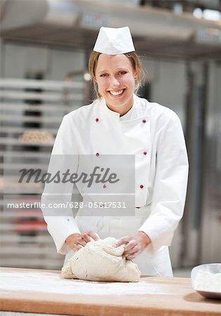 Smiling female baker working