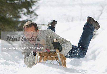 Homme sur un traîneau