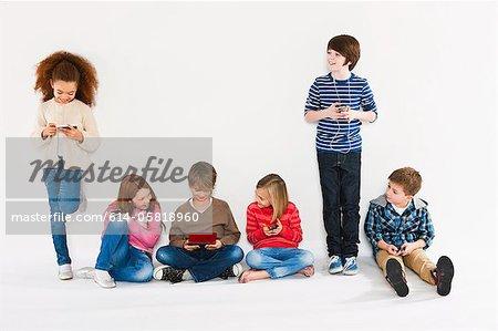 Children using different gadgets