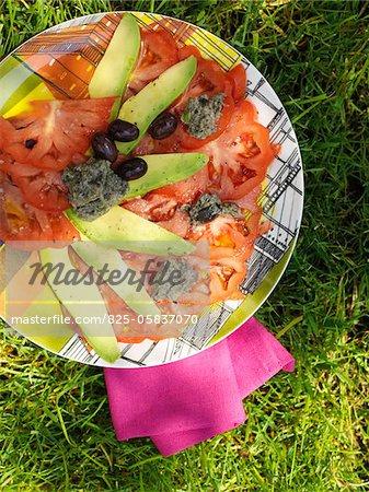 Avocado and tomato Carpaccio with tapenade