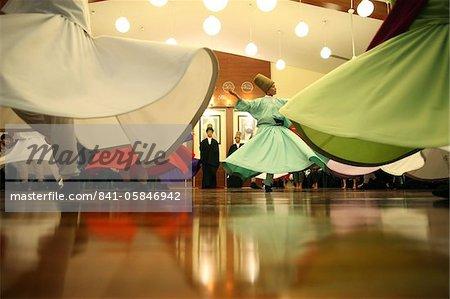 Whirling dervish performance in Silvrikapi Meylana cultural center, Istanbul, Turkey, Europe