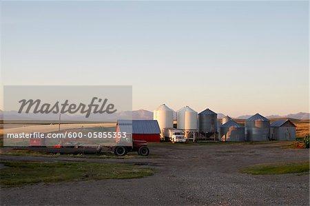 Farm with Barn, Tractors and Silos, Pincher Creek, Alberta, Canada