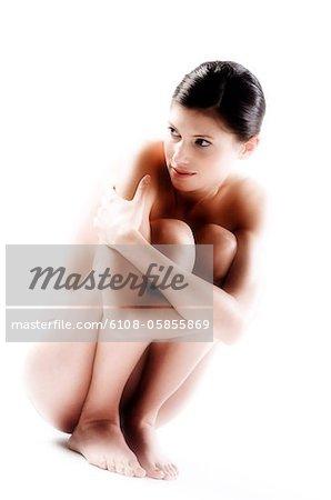 Frau hocke nackt