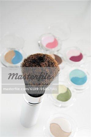 Eye-shadow boxes and make-up brush, close-up