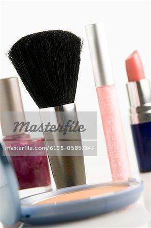 Eye-shadow box, nail polish, lipstick, mascara and make-up brush, close-up