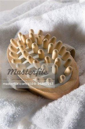 Wooden massager on a bath towel, close-up