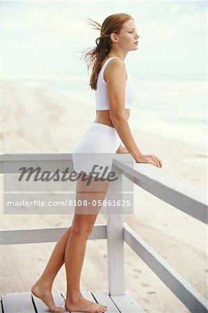 Young woman on a balcony, seaside
