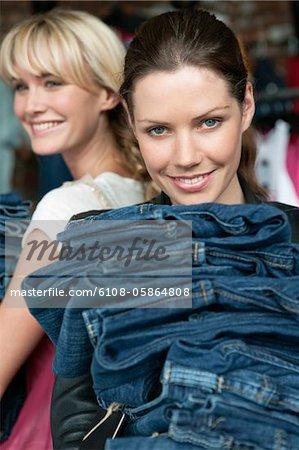 Women choosing dresses in a boutique