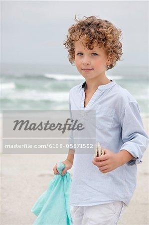 Portrait of a cute boy standing on beach