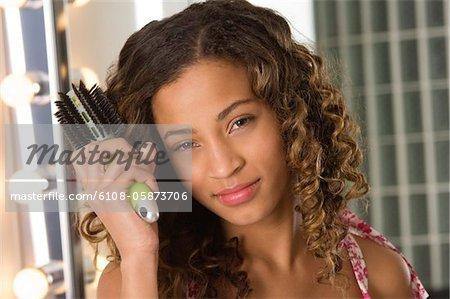 Portrait of a girl brushing her hair