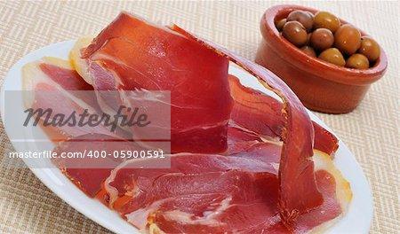 some spanish tapas, as serrano ham and olives