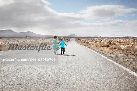 Children walking on paved rural road