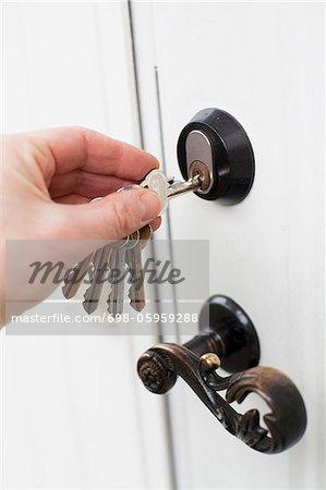 Hand unlocking the door