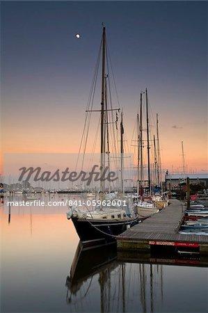 Evening draws in over a calm Lymington harbour, Lymington, Hampshire, England, United Kingdom, Europe