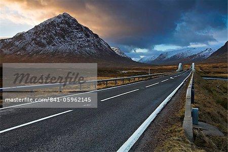 The A82 passing Buachaille Etive Mor as it winds through Rannoch Moor towards Glen Coe, Highland, Scotland, United Kingdom, Europe