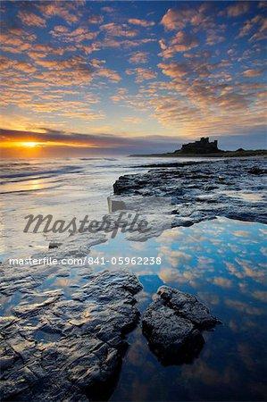 Spectacular sunrise over Bamburgh Castle, Northumberland, England, United Kingdom, Europe