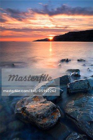 The sun sets over Gad Cliff and Hobarrow Bay, Jurassic Coast, UNESCO World Heritage Site, Dorset, England, United Kingdom, Europe