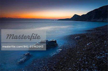 Twilight along the pebble shores of Worbarrow Bay, Jurassic Coast, UNESCO World Heritage Site, Dorset, England, United Kingdom, Europe