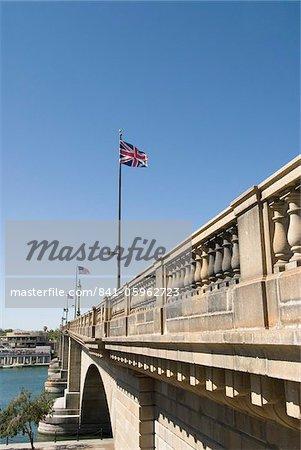 London Bridge with British flag in foreground, Havasu,  Arizona, United States of America, North America