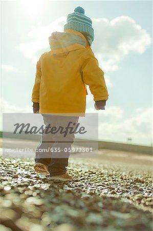 Toddler bundled up outdoors