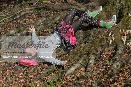 Teenage Girl Lying on Tree Roots