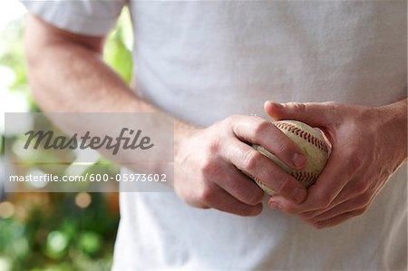 Man Holding Baseball