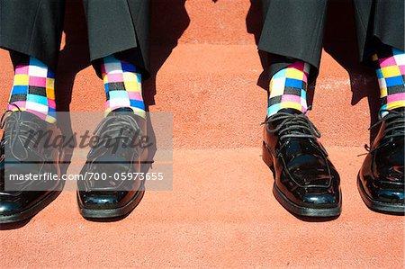 Geprüfte Socken und Kleid Schuhe