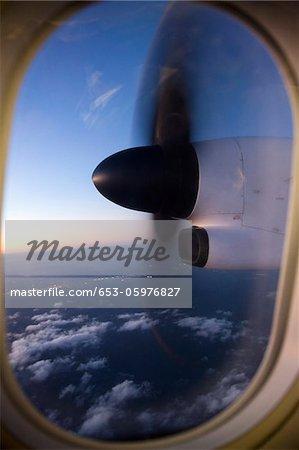 Moving airplane propeller seen through airplane window