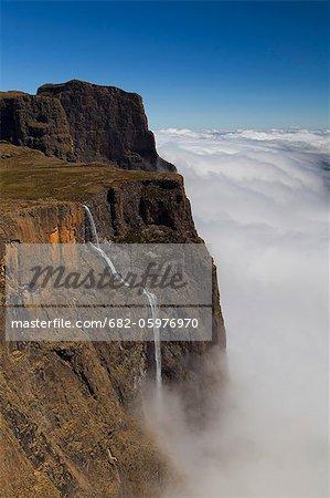 Tugela falls tumbling into misty Amphitheater, Drakensberg, South Africa