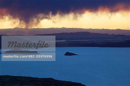 Storm clouds at sunset over Amantani Island, Lake Titicaca, Puno, Bolivia, South America