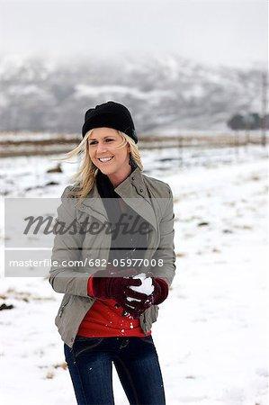 A young woman holding a snowball, Kamberg, KwaZulu-Natal, South Africa