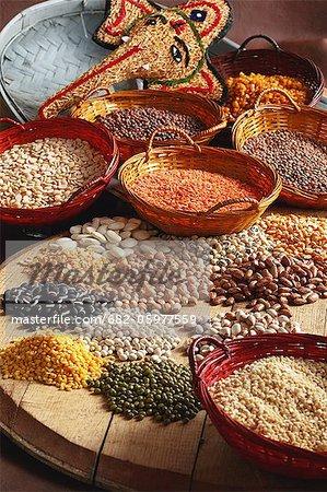 Indian cooking. Vaal ni dhal, chori beans, toover dhal, masoor, masoor ni dhal, split peas, rajma beans, lombhia beans, kidney beans, chana dhal, whole chana, papdi, haricot beans, moong dhal, moong, urad dhal, white-speckled sugar beans