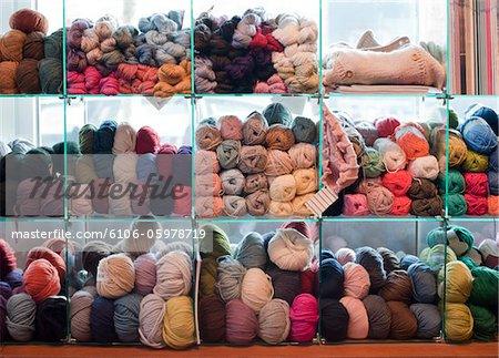 Knitting wools on shelves
