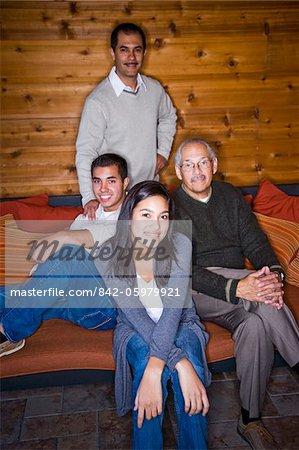 Portrait of three generations Hispanic family with teenage girl