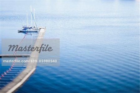 Sailboat anchored at jetty