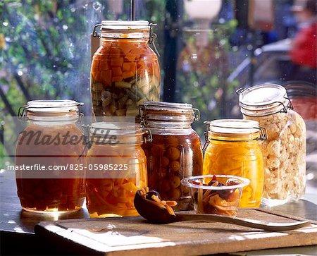jars of vinegar pickled vegetables